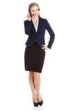 Beautiful business woman at call center. Stock Photo