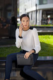 Beautiful business woman calling by phone Stock Photography