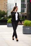 Beautiful business woman calling by phone Stock Photo