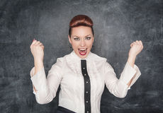 Beautiful business woman celebrating success Stock Photo