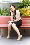 Beautiful Business Woman On Cell Or Mobile Phone. Young Stylish Business Woman Brainstorming A Group Discussion On A Mobile Or Cell Phone During A Teleconference Royalty Free Stock Images