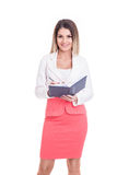 Beautiful business woman checking her agenda. Royalty Free Stock Images