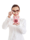 Beautiful business woman with coin and piggy- bank. Royalty Free Stock Photo