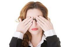 Beautiful business woman covering her eyes. Royalty Free Stock Image