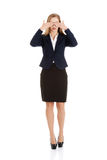 Beautiful business woman covering her eyes. Royalty Free Stock Photography