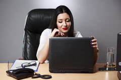 Beautiful business woman dreaming while working on computer at h. Er office Stock Photos