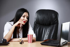 Beautiful business woman dreaming while working on computer at h. Er office Stock Images