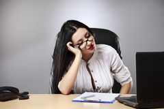 Beautiful business woman dreaming while working on computer at h. Er office Stock Photo