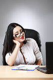 Beautiful business woman dreaming while working on computer at h. Er office Royalty Free Stock Images