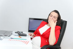 Beautiful business woman dreaming while working on computer at h Royalty Free Stock Photography