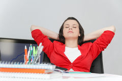 Beautiful business woman dreaming while working on computer at h Stock Image