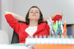 Beautiful business woman dreaming while working on computer at h Stock Images