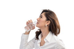 Beautiful business woman drinking water. From bottle royalty free stock photos