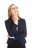 Beautiful business woman in eyeglasses with finger on her cheek. Stock Photo