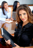 Beautiful business woman with a folder Royalty Free Stock Photos