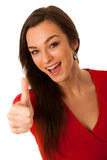 Beautiful business woman gesturing success with showing thumb up Royalty Free Stock Photo