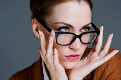 Beautiful business woman with glasses Stock Images