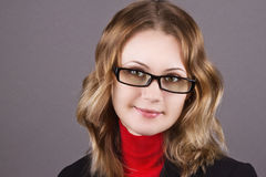 Beautiful business woman in glasses. Portrait of a beautiful young business woman in glasses Stock Image