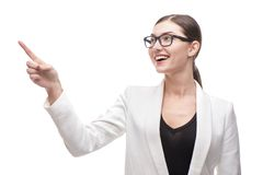 Beautiful business woman with glasses pointing at Stock Photography