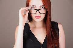 Beautiful business woman in glasses Stock Image