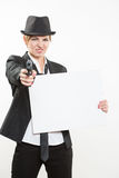 Beautiful business woman with gun olding a blank billboard. Royalty Free Stock Image