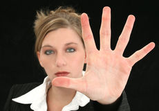 Beautiful Business Woman with Hand Palm Out in Front of Her royalty free stock photography
