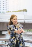 Beautiful businesswoman hands holding gold trophy cup,Success and victory concept. Beautiful business woman hands holding gold trophy cup,Success and victory stock image