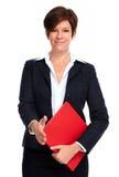 Beautiful business woman with handshake. Royalty Free Stock Photo