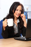 Beautiful business woman has coffee at work Royalty Free Stock Photography
