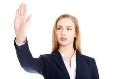 Beautiful business woman is having had up showing stop gesture. Royalty Free Stock Photography