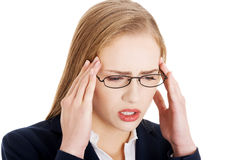 Beautiful business woman is having a headache. Royalty Free Stock Photos