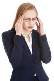 Beautiful business woman is having a headache. Stock Photos