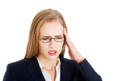 Beautiful business woman is having a headache. Royalty Free Stock Photography