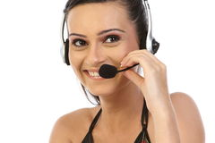 Beautiful business woman with headset. Royalty Free Stock Photo
