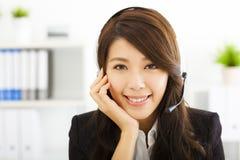 Beautiful business woman in headset Stock Photo
