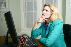Beautiful Business Woman At Her Desk Thinking Royalty Free Stock Images