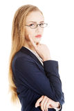Beautiful business woman with her finger on cheek thinking. Stock Photo
