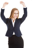 Beautiful business woman with her hands up. She's satisfied. Stock Photos