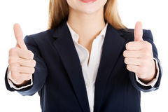 Beautiful business woman with her thumb up, showing oK. Stock Image