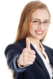 Beautiful business woman with her thumb up, showing oK. Royalty Free Stock Photos