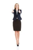 Beautiful business woman with her thumb up, showing oK. Isolated on white Royalty Free Stock Photo