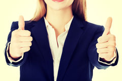Beautiful business woman with her thumbs up. Royalty Free Stock Images