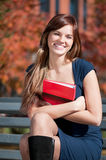 Beautiful business woman hoding diary at park Royalty Free Stock Image