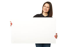 The beautiful business woman holding a banner. Isolated Royalty Free Stock Photo