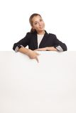 Beautiful business woman holding blank billboard Stock Photo