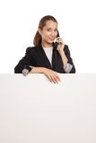 Beautiful business woman holding blank billboard Royalty Free Stock Photography