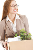 Beautiful business woman holding box with office items. Starting Royalty Free Stock Image