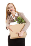 Beautiful business woman holding box with office items. Stock Photography