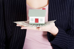 Beautiful business woman holding dollar currency and house. Close up Stock Images