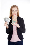 Beautiful business woman holding dollar currency and house. Isolated on white Stock Image